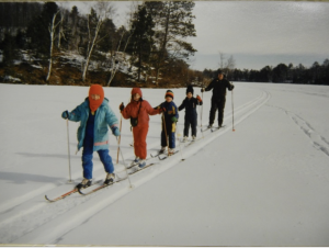 Children cross country skiing on frozen Lake Owen